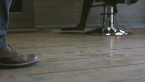 Man in shoes walks the wooden floor