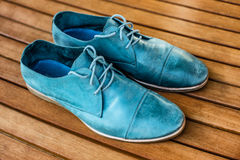 Man shoes on wooden background Royalty Free Stock Images