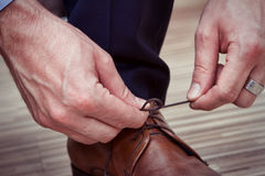 Man and shoes. Young man and brown boots Royalty Free Stock Photography