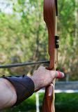 A man shoot away an arrow with a bow. royalty free stock images