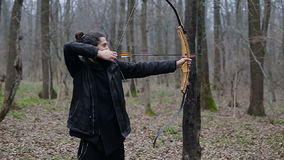 Man shoot with a bow in the forest. Man shoot with a recurve bow in the forest stock video