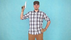 Man shooter athlete with a gun and glasses looking at the camera smiling. Portrait of a man shooter athlete with a gun and glasses looking at the camera smiling stock footage