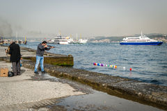 Man is shooting ballons in Istanbul, Turkey Royalty Free Stock Photography