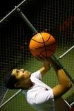 Man shooting basketball. A young man shooting a basketball royalty free stock image