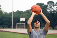 Man Almost Shooting Basketball - horizontal Stock Photos