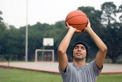 Man Almost Shooting Basketball - horizontal Stock Photos