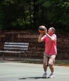 Man shooting basketball 3 Stock Image