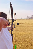 Man shooting bow Royalty Free Stock Images