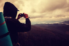 Man shooting in Carpatian mountains Stock Photography