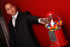 Man shooting gumball machine Royalty Free Stock Image