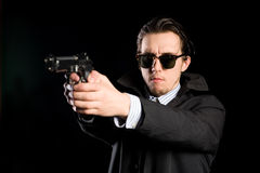 Man shooting a gun Stock Photo