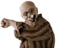 Man shooting a gun. The man shooting a gun by the purpose on a white background Royalty Free Stock Photography