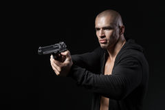 Man shooting gun  on black Royalty Free Stock Photography