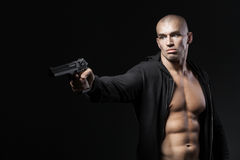Man shooting gun isolated on black Royalty Free Stock Photography