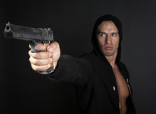 Man shooting gun isolated on gray background Royalty Free Stock Photo