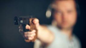 Man shooting with gun at a target.  stock footage