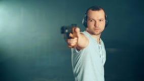 Man shooting with gun at a target.  stock video