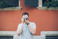 Man shooting with old retro camera Royalty Free Stock Photo