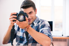Man shooting with photo camera Stock Images