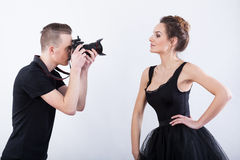 Man shooting a photo of elegant dancer Stock Photos