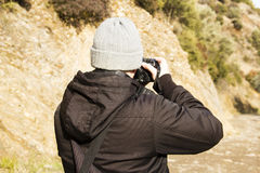 Man Is Shooting Photo At Mountain Royalty Free Stock Photography