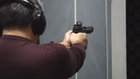 Man shooting with a pistol stock video footage