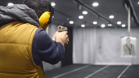 Man shooting with a pistol in slow motion stock footage
