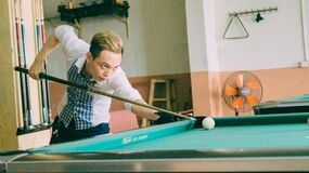 Man shooting pool Stock Image