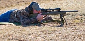 Man Shooting Rifle stock photography