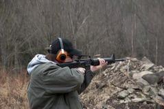 Man shooting rifle Royalty Free Stock Images