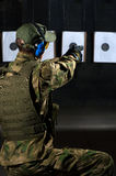 Man shooting. With rifle at a target in shooting range Royalty Free Stock Photography