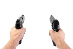 Man shooting with two guns Royalty Free Stock Photo