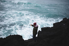 Man Shooting Video by Phone. Man shooting videj of Iceland sea by phone Royalty Free Stock Image