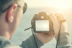 Man shoots at camera. Royalty Free Stock Photos
