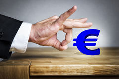Man shoots Euro sign off Stock Photography