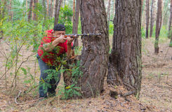 Man shoots in a forest Stock Photography