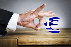 Man shoots greek Euro sign off Stock Image