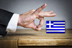 Man shoots Greek Flag off Royalty Free Stock Photo
