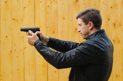 The man shoots from a pistol Stock Photography