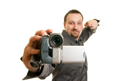 Man shoots video with a camera. Man shoots with a camera Royalty Free Stock Images