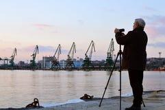 Man shoots video of Varna docks at dusk Stock Images