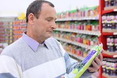 Man in shop with package in hands Stock Image