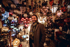 Man in shop of traditional lamps Stock Image