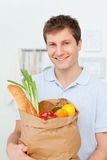 Man with shoping bags in the kitchen. At home royalty free stock photos