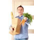 Man with shopping bag Stock Images