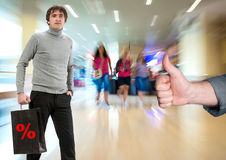 Man with shopping bag, another man gesturing thumb up Royalty Free Stock Images