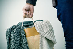 Man with a shopping bag with clothes Stock Images