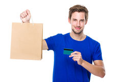 Man with shopping bag and credit card Stock Photos