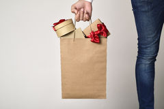 Man with a shopping bag full of gifts Royalty Free Stock Photo