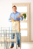 Man with shopping bag at home Royalty Free Stock Photo